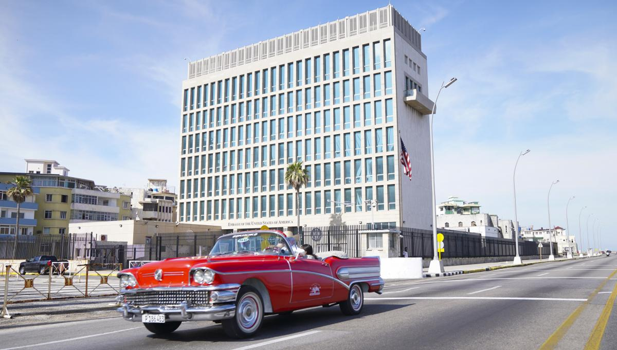 A car drives past the U.S. Embassy in Havana in 2019. More than 40 Americans working at the embassy suffered from unexplained ailments that included headaches, balance problems and memory loss.