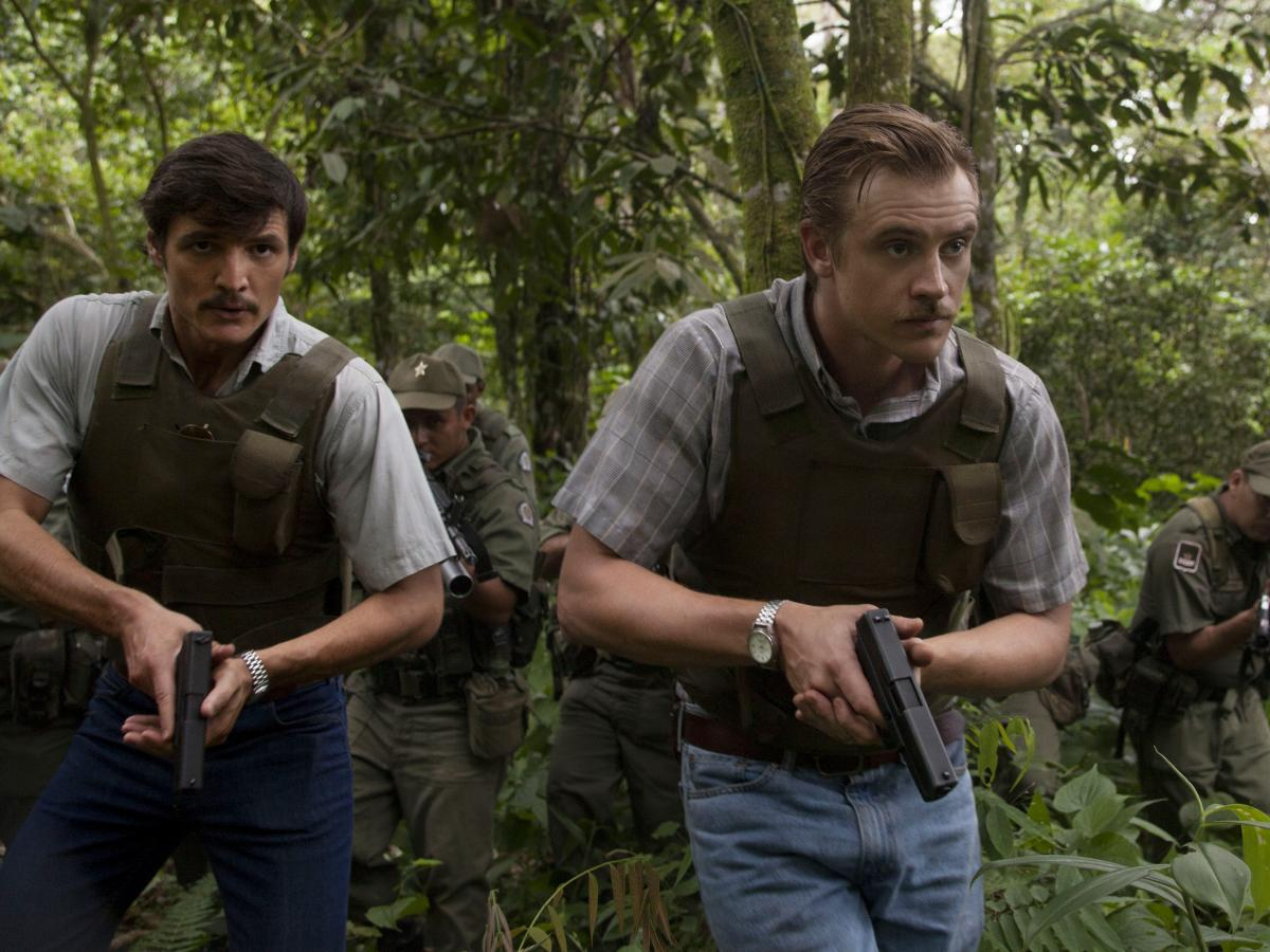 DEA agents Javier Peña (Pedro Pascal, left) and Steve Murphy (Boyd Holbrook) work together to bring Escobar down in Netflix's Narcos.
