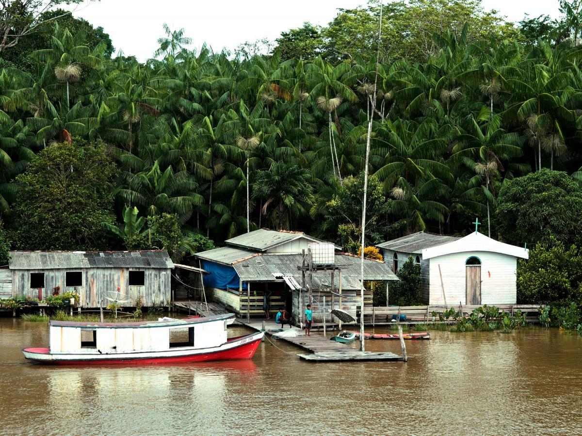 As the Amazon narrows in an area called the Breves Strait, residents of small riverside communities come out to watch the passing ships. Longtime sailors have watched these communities grow slowly less poor over the years, acquiring satellite dishes and s