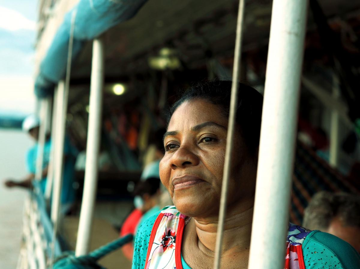 Christian missionary Mari Dalva, 50, travels the Amazon several times per year in search of people who need help along the shore and on board. Aboard the White Swan, she organizes nightly prayer circles with other evangelicals she meets.