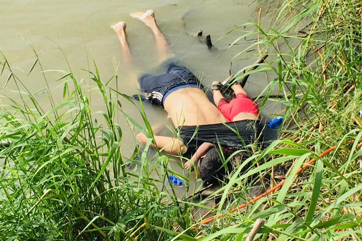 The bodies of Óscar Alberto Martínez Ramírez and his nearly 2-year-old daughter, Valeria, lie on the bank of the Rio Grande in Matamoros, Mexico, where they were found Monday morning. They drowned while trying to cross the river to Brownsville, Texas.