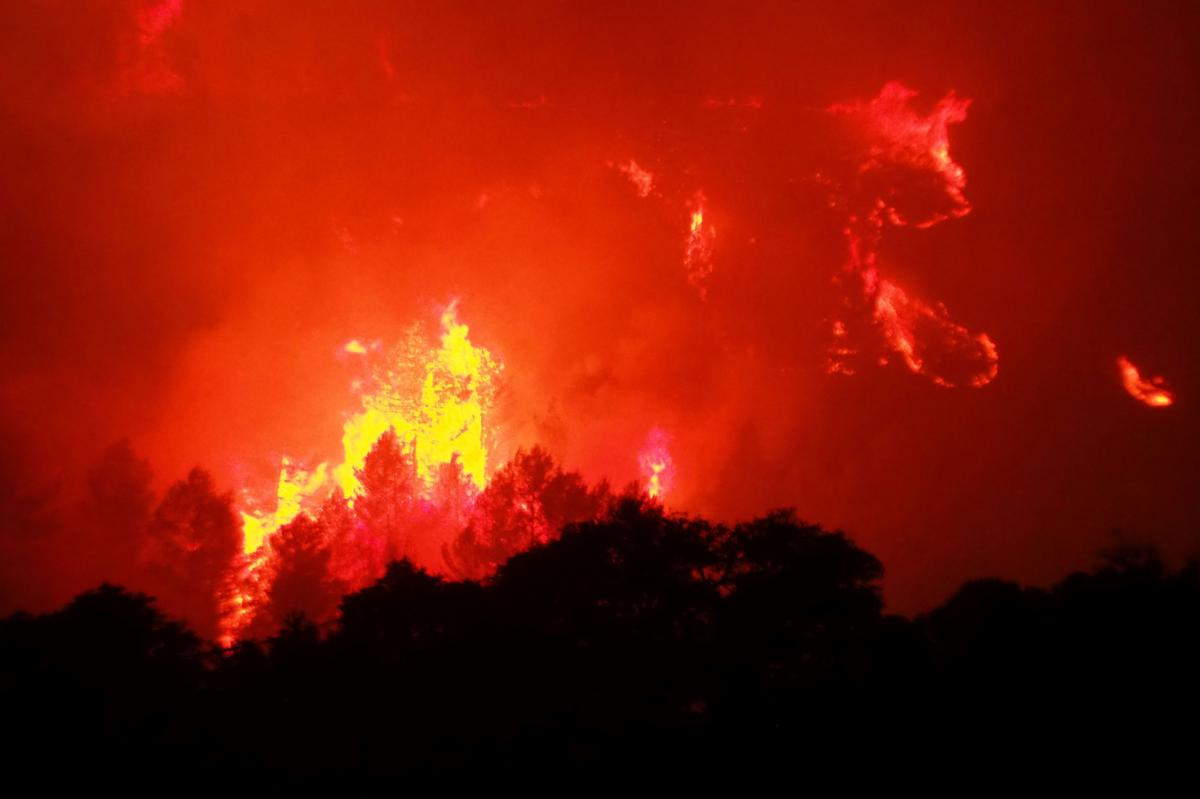 A fire near the village of Monze, in the Aude department of southern France, on Aug. 15. The fire, which broke out the day before following a drought, burned up more than 2,000 acres.