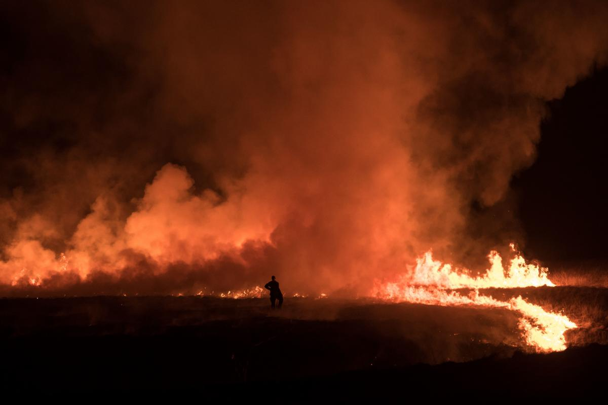 Firefighters tackle a blaze on moorland above the village of Marsden, England, on April 21.