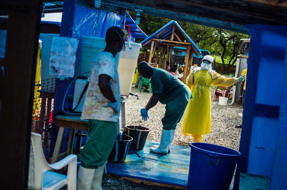 A health worker prepares to exit the isolation area at the Ebola clinic run by Doctors Without Borders in Lofa County, Liberia. The exponential growth of the outbreak is most aggressive in Liberia.