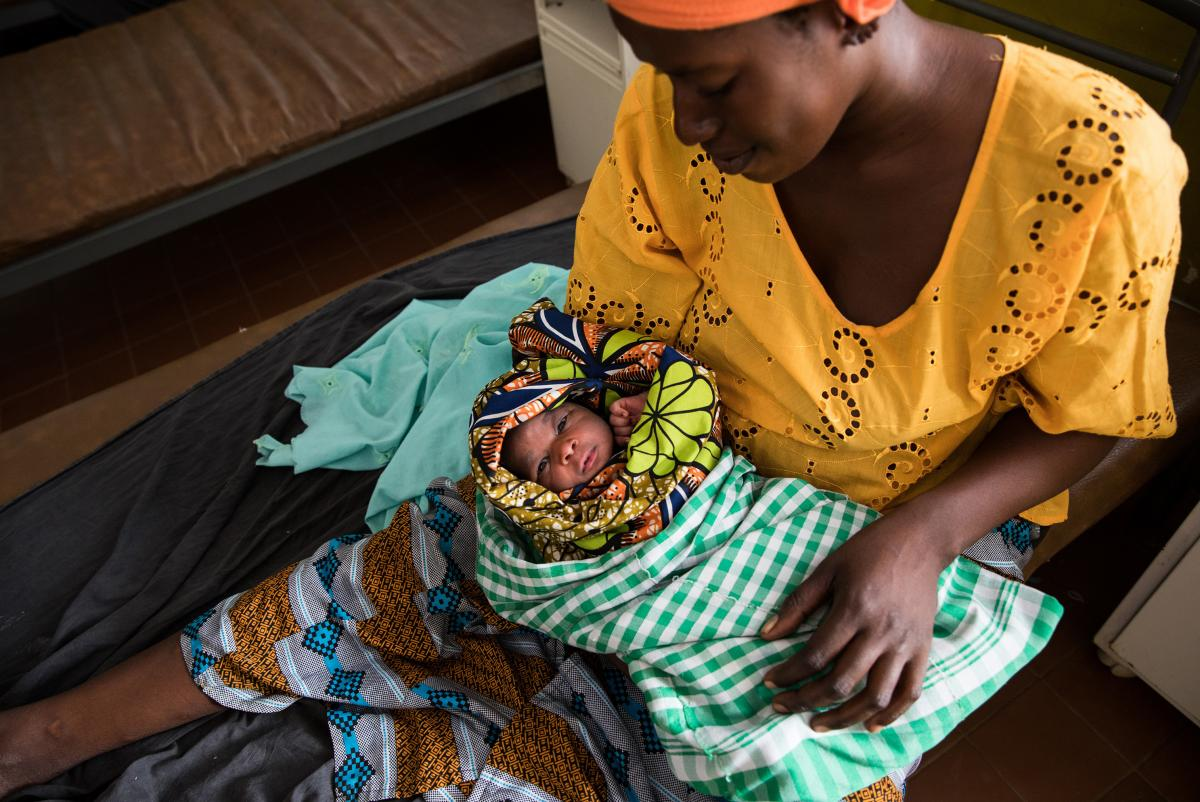 Naba Dabo, 25, holds her day-old baby at the maternity ward of the Brufut Minor Health Center outside of Banjul in the Gambia. The midwives at the clinic say that they don't administer pain medication during childbirth because, in their view, most of the