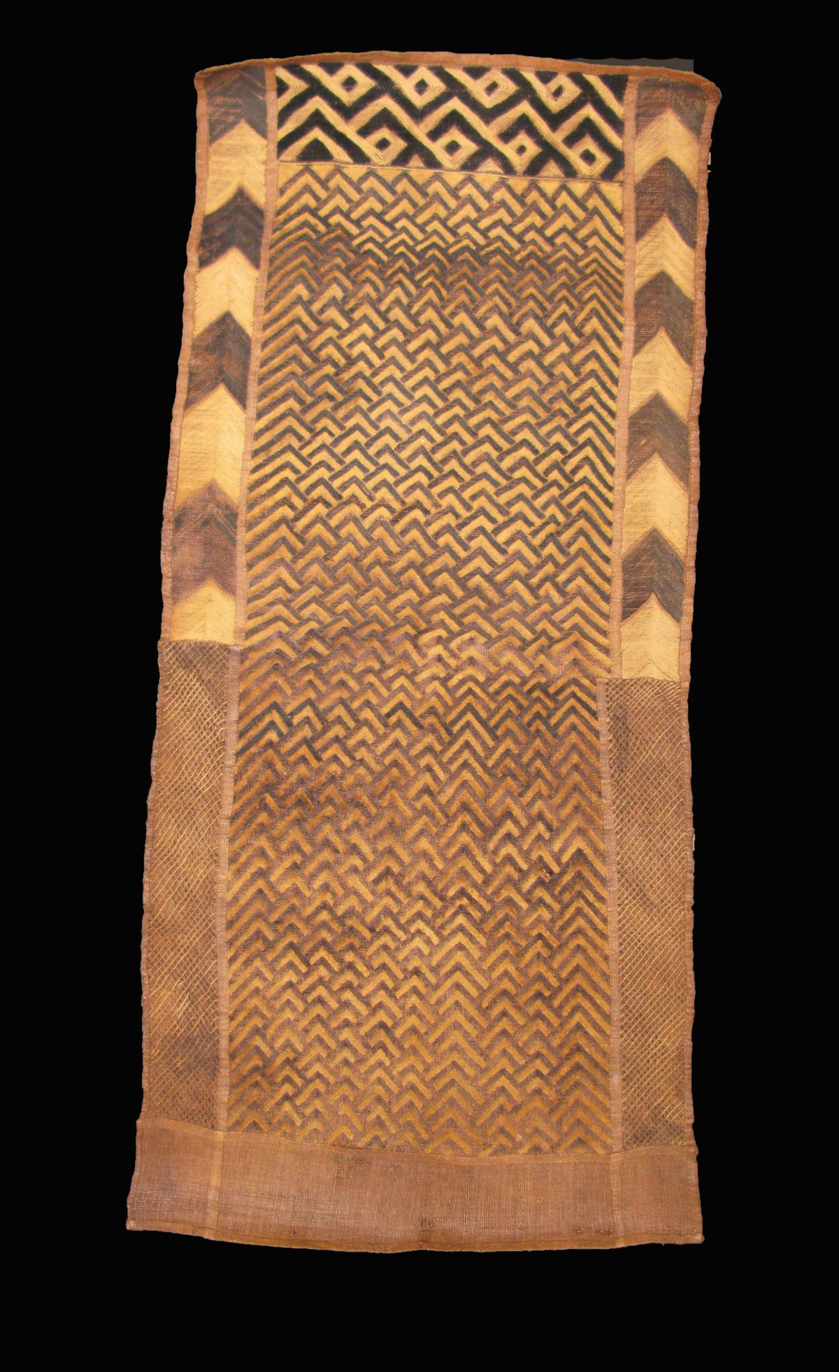 This textile, dated to 1807‑1869, would have been wrapped around the wearer as an overskirt. It is thought to be a unisex garment.