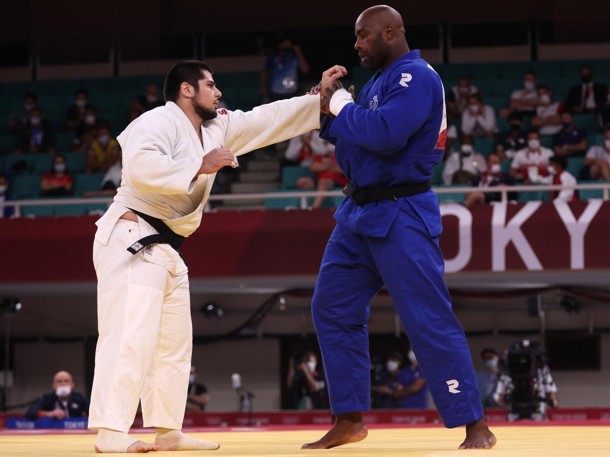 France's Teddy Riner (right) and Tamerlan Bashaev of the team from Russia compete Friday during the men's judo over 100-kilogram quarterfinal at the Tokyo Olympics.
