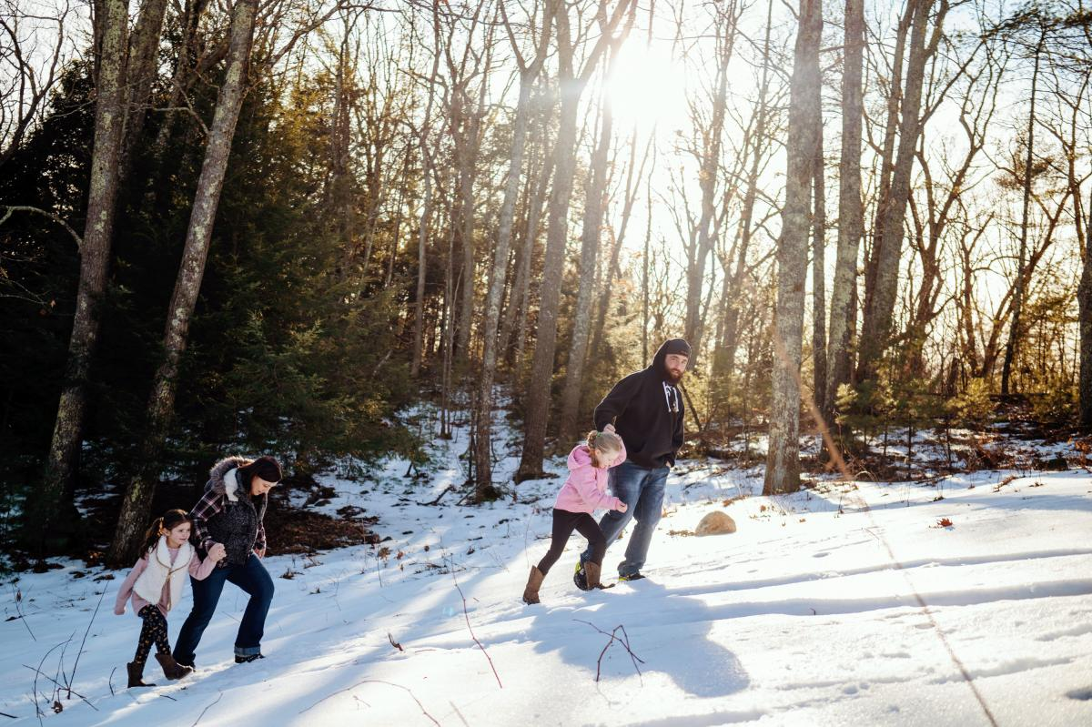 The Fords go for a walk down to the river on their 10-acre property, where they see everything from deer to moose to bald eagles. From left to right, Mckinley, 5; Jennifer; Addison, 7; and Andrew Ford.
