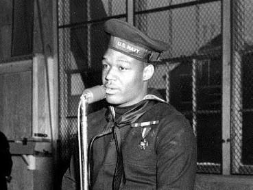 Miller speaks during a war bond tour stop at the Naval Training Station in Great Lakes, Ill., on Jan. 7, 1943.