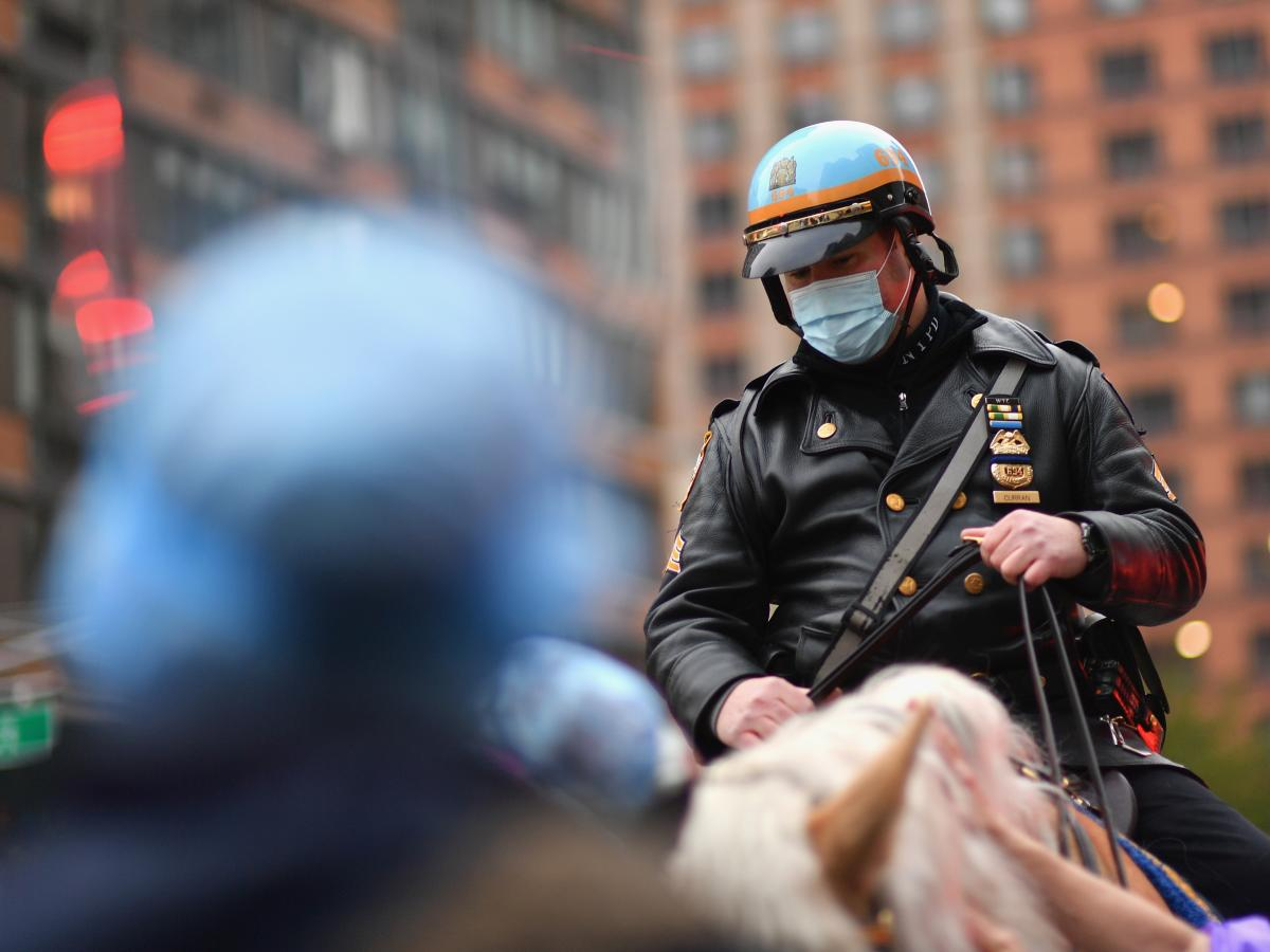 A mounted New York City police officer sits outside a hospital in Manhattan last month. Gov. Andrew Cuomo said he was encouraging officers to strictly enforce a state rule mandating face coverings in public.