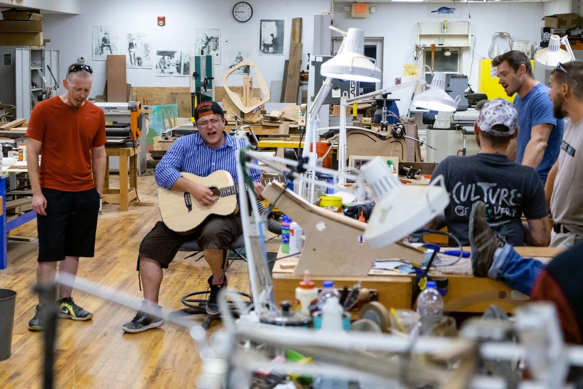 A group of guys from the local recovery center play music at the luthiery. They like to sing country singer Tyler Childers' songs together.