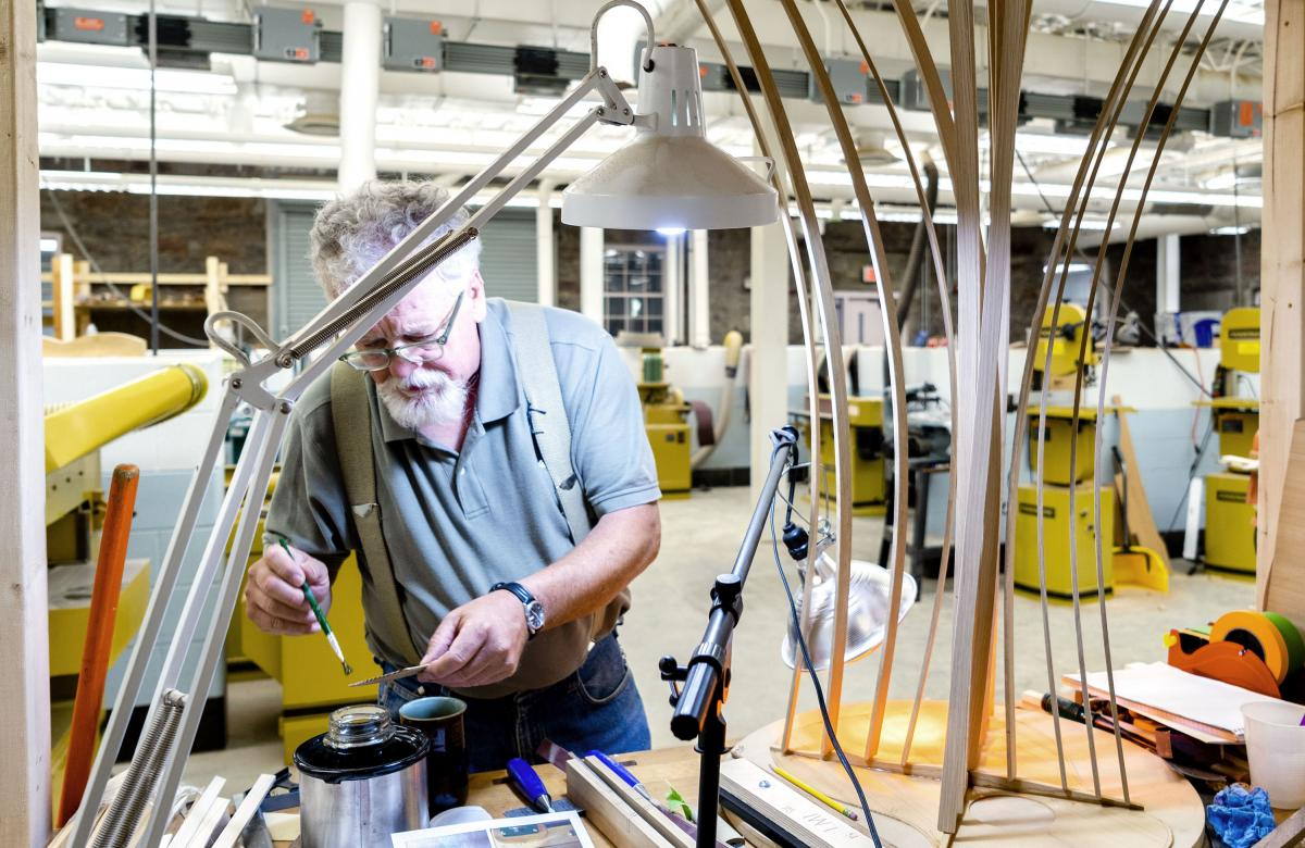 Doug Naselroad prepares glue to help build his guitar. He started the Troublesome Creek Stringed Instruments Company in May.