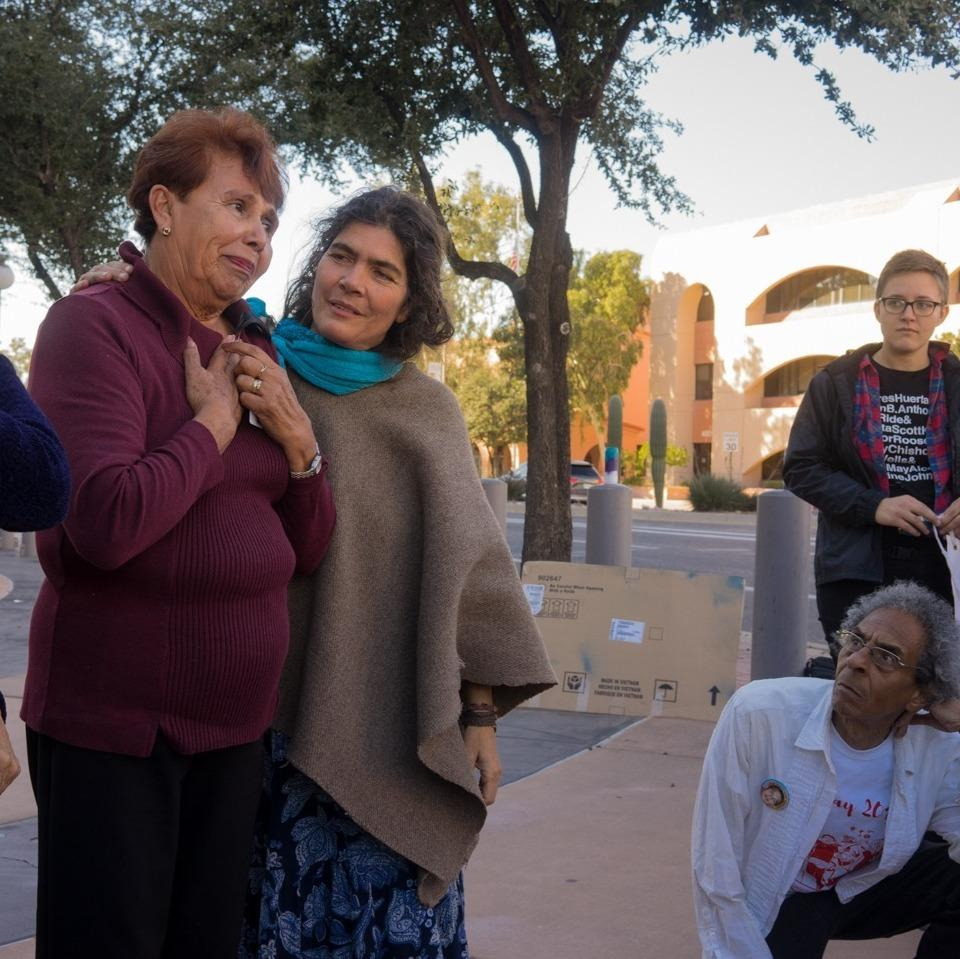 The victim's grandmother, Taide Elena, outside of the courtroom with supporters. She led the fight to put Border Patrol Agent Lonnie Swartz on trial for killing her grandson, Jose Antonio Elena Rodriguez.
