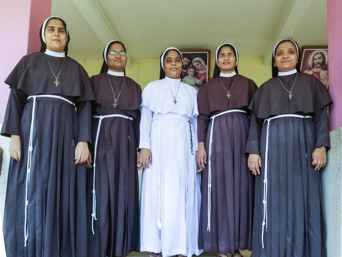 From left: Sisters Alphy, Anupama, Ancitta, Neena Rose and Josephine stand on the steps of their convent in southern India's Kerala state.