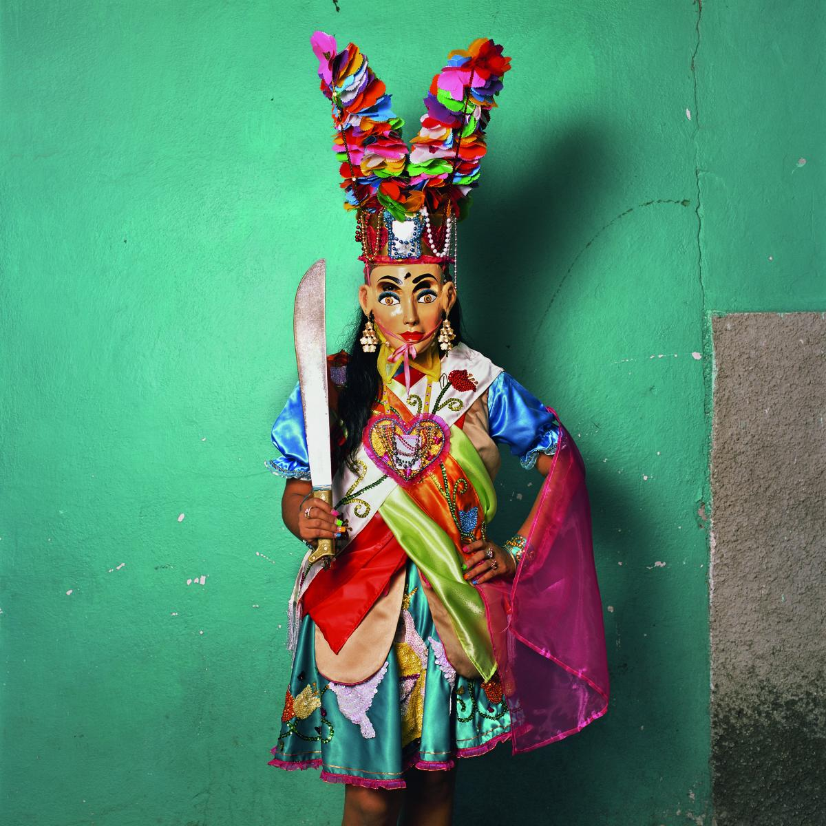 A regal costume from the state of Guerrero, where festivals draw from both Catholic and Mesoamerican themes. The sword-wielding queen leads a pageant group. In the past, men have played the part, but now women are starting to get involved.