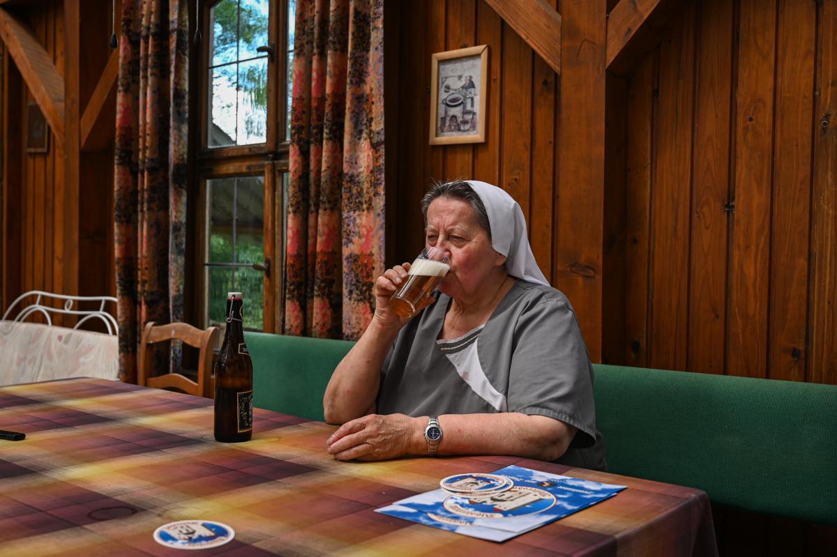 Sister Doris drinks her after work beer.