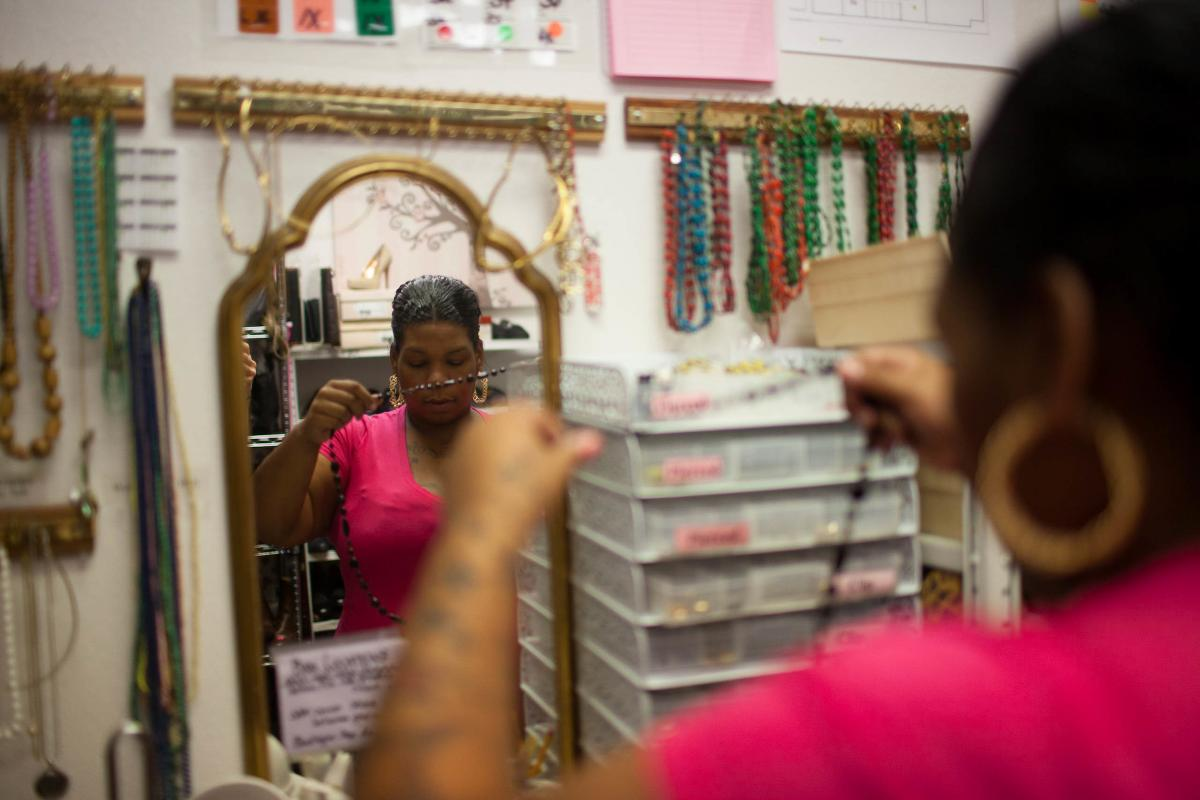 While her daughter and son are at school at Positive Tomorrows, Brenda tries on clothes. A caseworker with Positive Tomorrows brought a small group of moms to Suited for Success, a nonprofit in Oklahoma City that gives women outfits for job interviews.