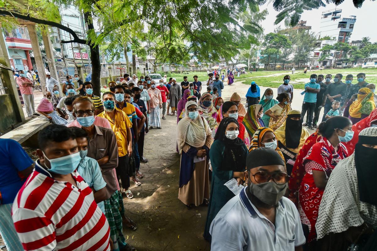Bangladeshis line up (and mask up) last week for the coronavirus vaccine.