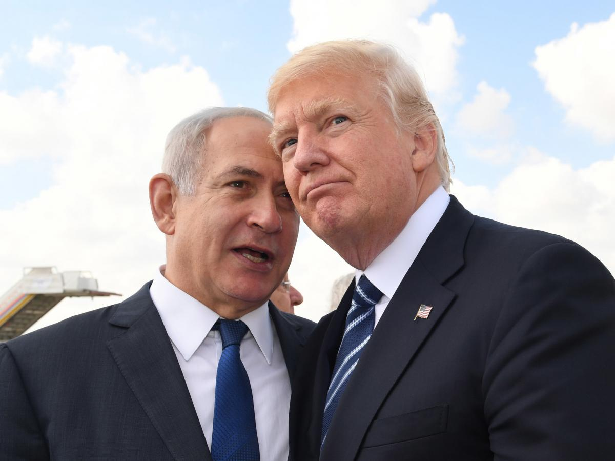 Israeli Prime Minister Benjamin Netanyahu speaks with Trump before the president's departure from Ben-Gurion International Airport in Tel Aviv in May 2017. The visit was part of Trump's first Middle East trip after taking office.