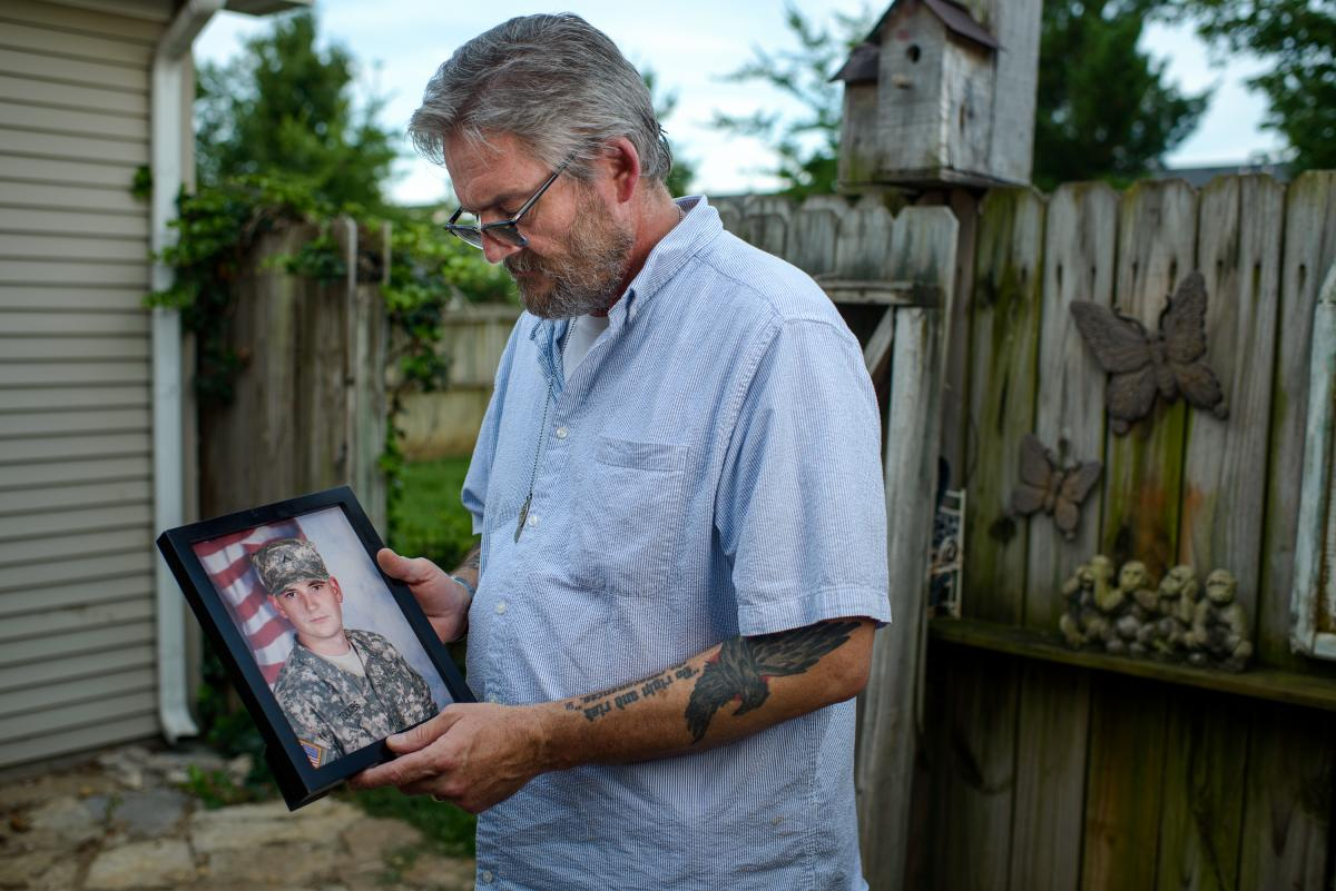 David Toombs holds a photo of his son, John, at his home in Murfreesboro, Tenn. Former Sgt. John Toombs developed a drug problem after he left the Army and was in a residential treatment program at the Murfreesboro Veterans Affairs center. In 2016, he kil