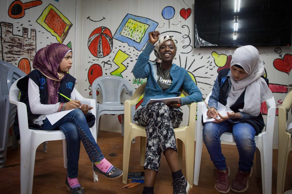 Emi Mahmoud conducts a poetry workshop with children at the community center in the Zaatari refugee camp in Jordan.