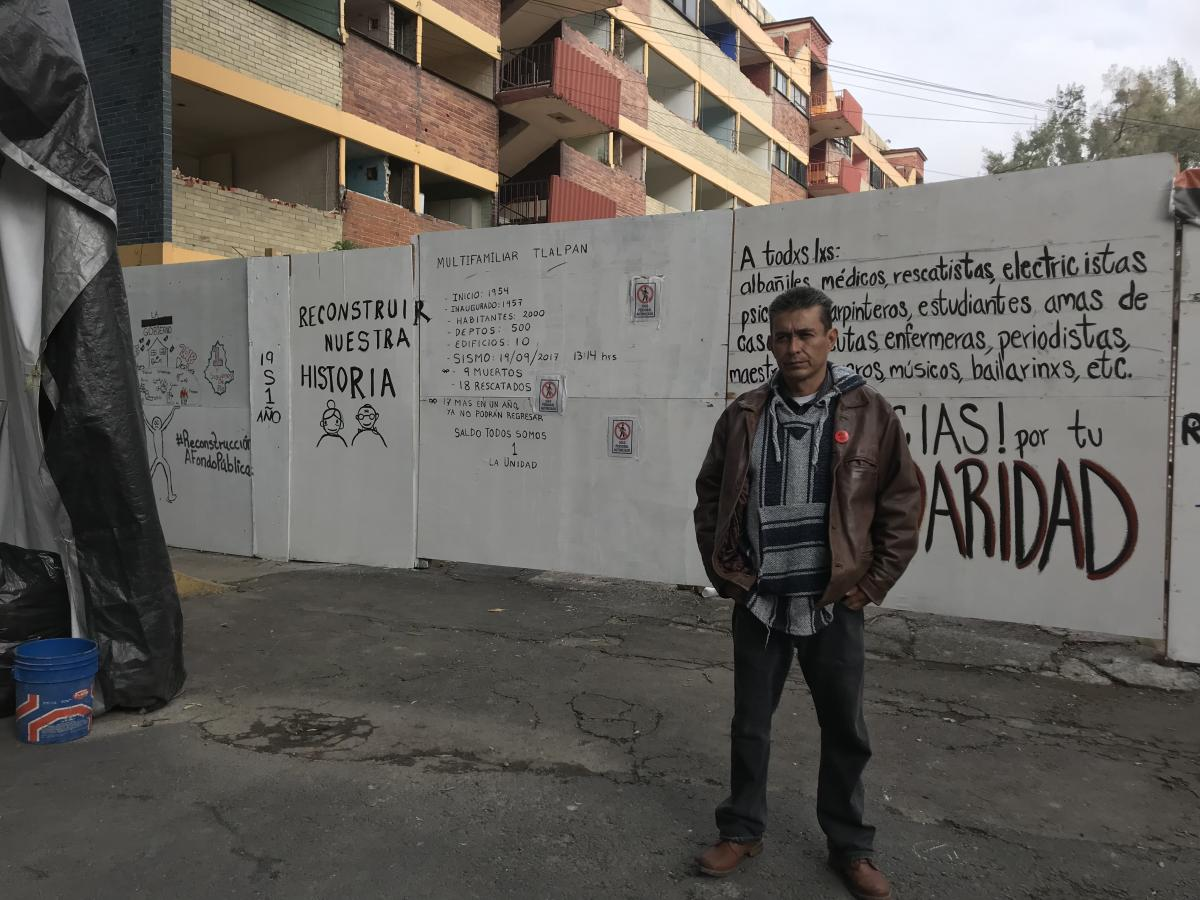Angel Fuentes Martínez, 50, receives about $200 per month in government aid as an earthquake victim. But he says it's not enough to rent a new apartment, and he often spends it on health care since he frequently gets sick living in a tent next to the com