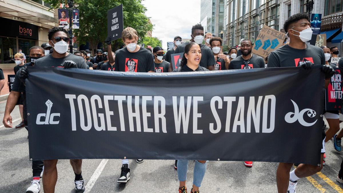 Demonstrators take part in a Juneteenth march and rally in Washington, D.C. — one of a number of major cities to see large gatherings commemorating the date.