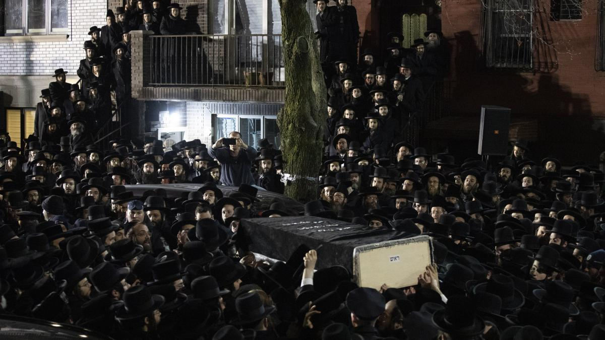 Orthodox Jewish men carry the casket of Jersey City victim Moshe Deutsch outside a Brooklyn synagogue following his funeral Wednesday in the Williamsburg neighborhood of Brooklyn.