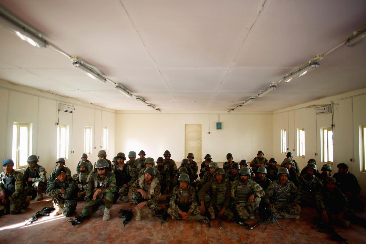 Afghan soldiers assemble at Camp Eagle in Shah Joy district in Zabul province. The Afghan army now looks like a professional army; its soldiers are eager to go out and take on the Taliban.