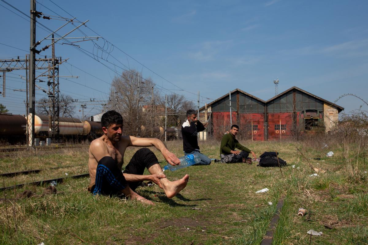 Jihan Zeb (left), from Afghanistan, and other asylum seekers found refuge in an abandoned railway station in the Serbian city of Subotica, on the border with Hungary. They say they have each tried to cross into neighboring EU countries more than 10 times