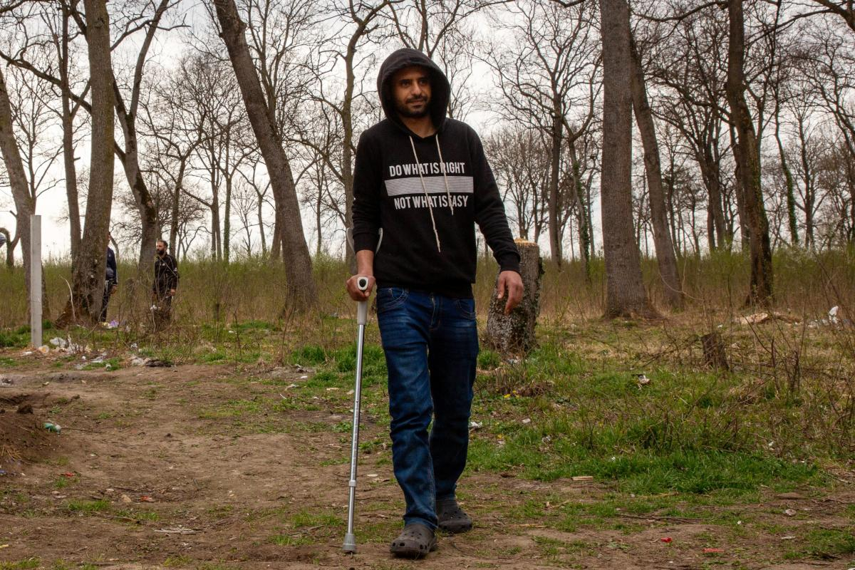 Ahmad al-Ghazali, from Syria, lives just outside the perimeter of Sombor camp in Serbia's north, near the borders with Croatia and Hungary. He was injured during a recent attempt to cross into the EU, he says, when he tried jumping the barrier that Hungar