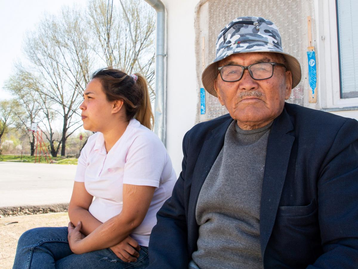 Afghan Masouma Musavi, 24, and her father Reza Musavi, 85, sit in the Krnjaca asylum center near the Serbian capital Belgrade. They arrived in the country with Masouma's mother and daughter in 2017, after walking across Iran.