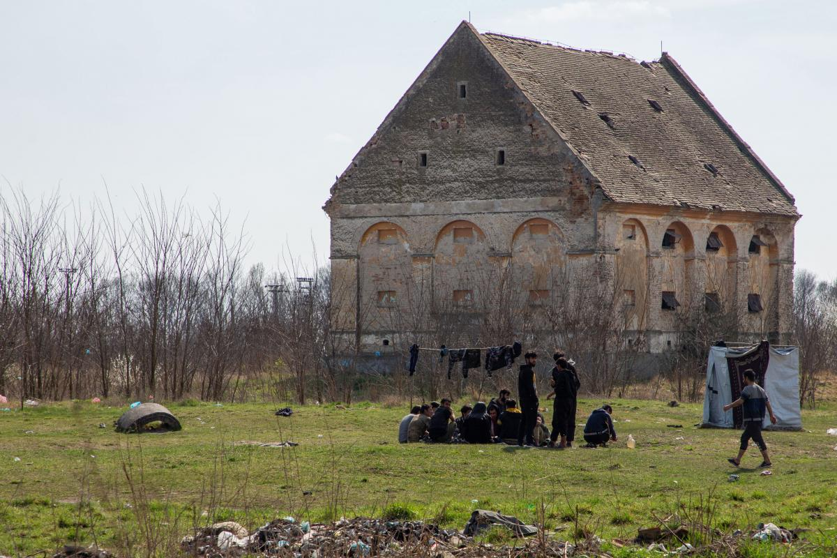 Migrants who don't stay in Serbia's state-run camps sleep in makeshift shelters, abandoned houses or in fields and forests along the borders. Asylum-seekers from Afghanistan sit in an abandoned farm field on the outskirts of the village of Horgos, a few p