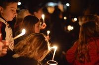 Aztec High School students and residents gathered for a candlelight vigil in December after the shooting at their high school.