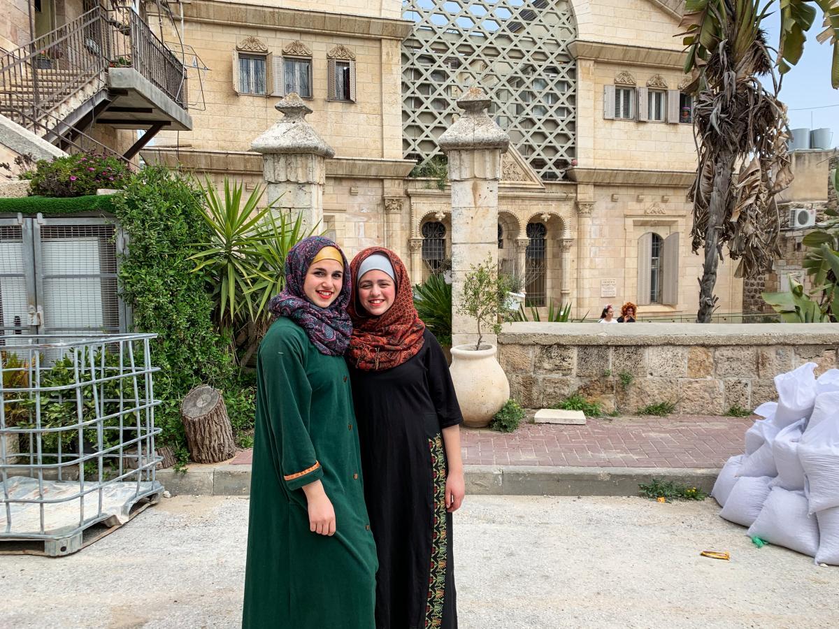 Israelis dressed up in costume as Palestinian Muslim women for Purim in Hebron.
