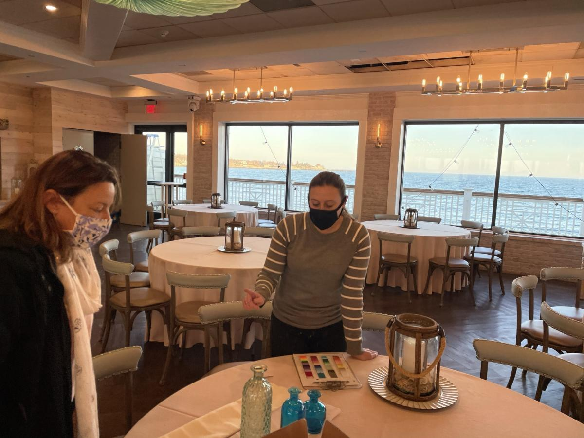 Soon-to-be bride Tricia Henderson (left) scrutinizes napkin colors with Allison Loomis of Oceanview of Nahant.