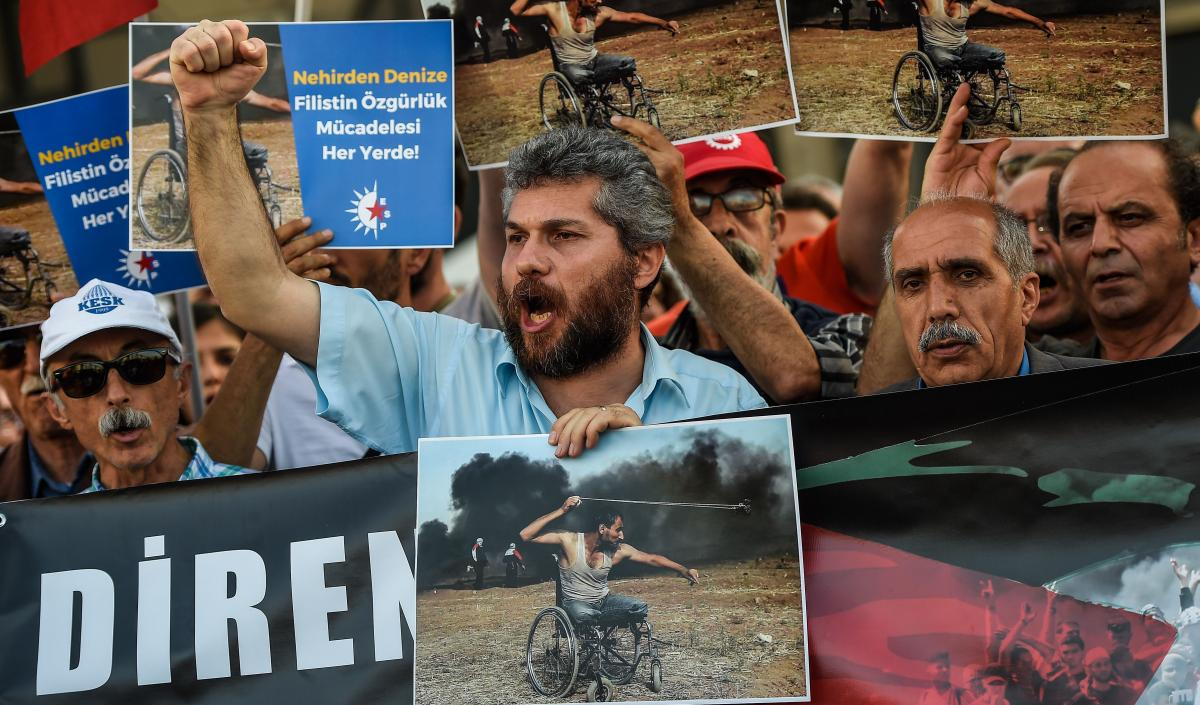 Turkish demonstrators bear signs proclaiming their solidarity with the Palestinians during a rally Tuesday in Istanbul. Turkey's leftist opposition party called the demonstration to protest the killing, the day before, of dozens of Palestinians during cla