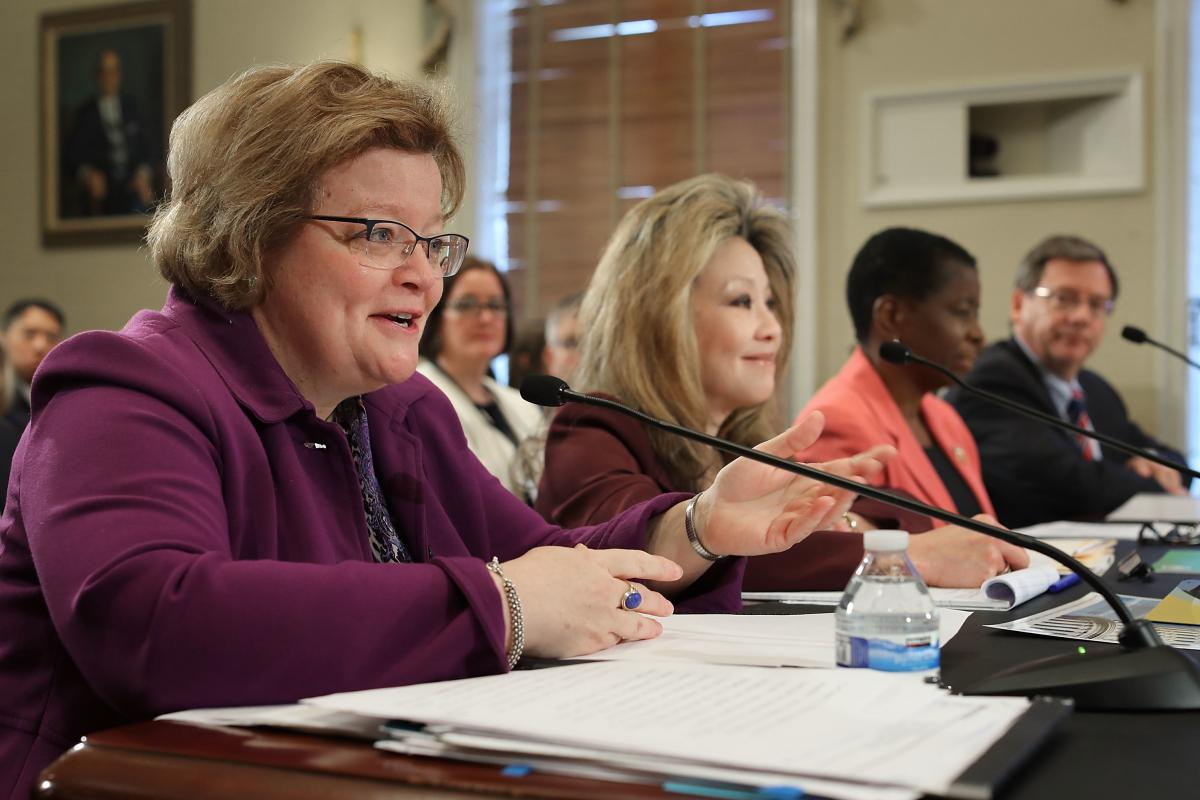 Victoria Lipnic (left), acting chair of the Equal Employment Opportunity Commission, testifies before the House Administration Committee during a hearing on preventing sexual harassment in Congress in December 2017.