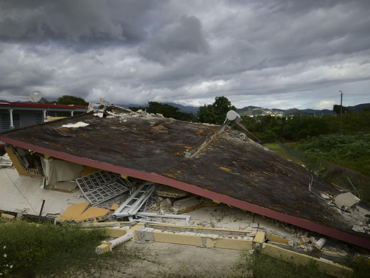 A collapsed structure lies after the previous day's magnitude 6.4 earthquake in Yauco, Puerto Rico.