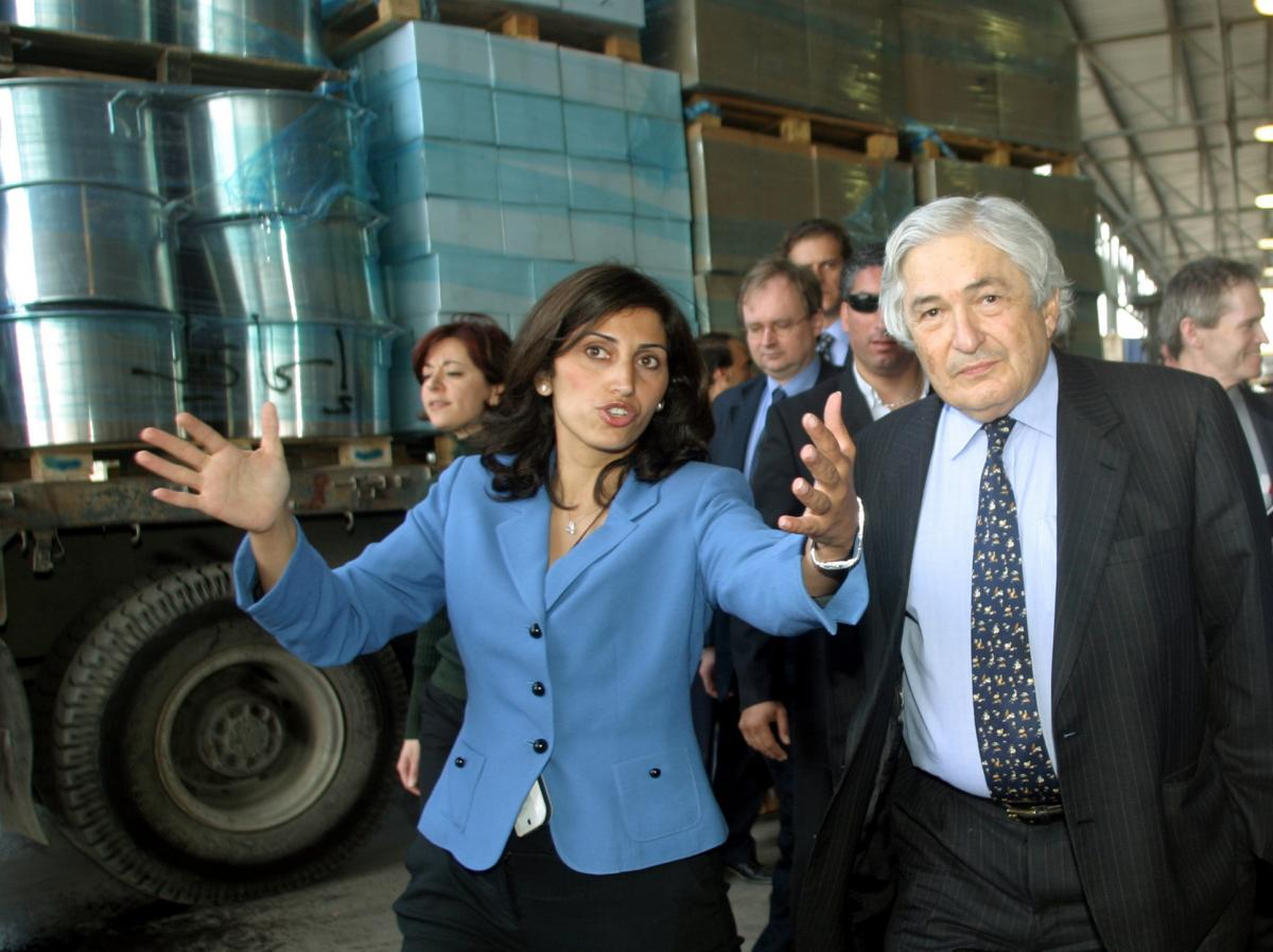 Diana Buttu seen in 2005, when she served as an adviser to a Palestinian cabinet minister,  accompanies then-World Bank President James Wolfensohn, during their a tour of the Gaza Strip.