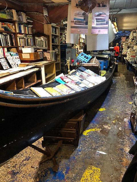 The books at Venice's Acqua Alta (High Water) bookstore have always been displayed inside bathtubs, plastic bins and even a full-size gondola.
