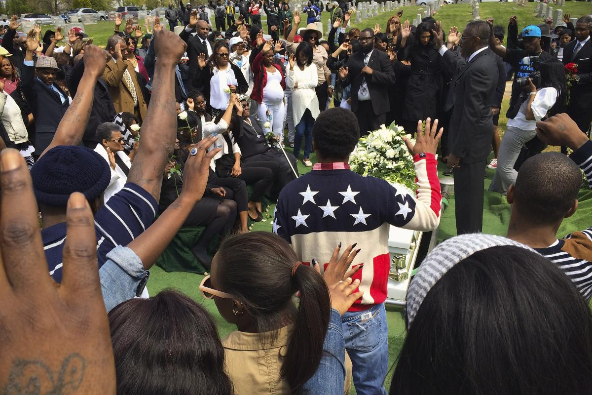 Friends and relatives say their last goodbyes to Freddie Gray during a graveside service at Woodland Cemetery.