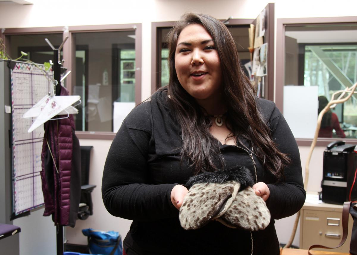 Cordelia Kellie showing off her seal skin gloves, purchased at a dance festival and made by a woman from Shishmaref.