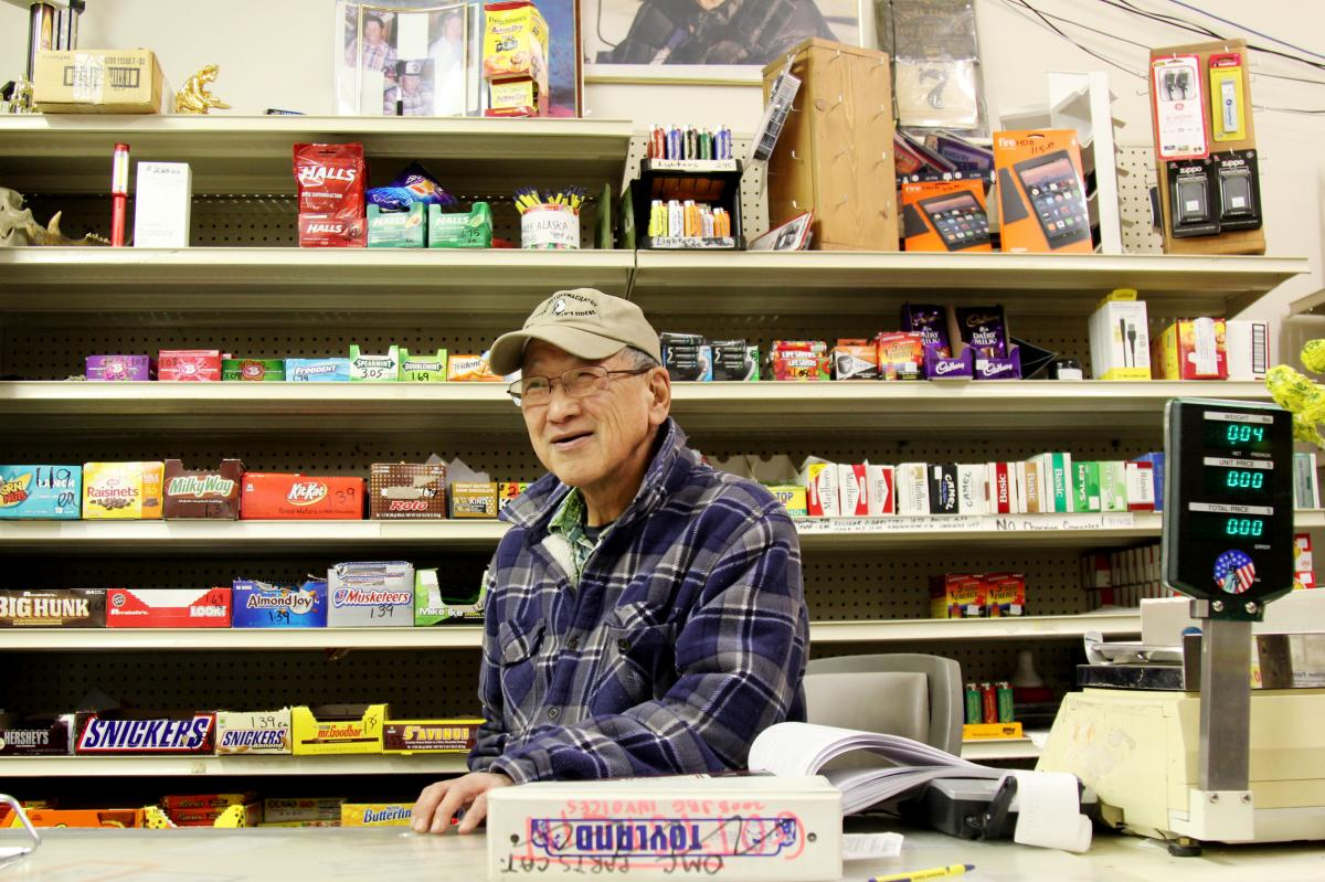 Percy Nayokpuk behind the counter at the Nayokpuk General Store, which his father opened in 1960.