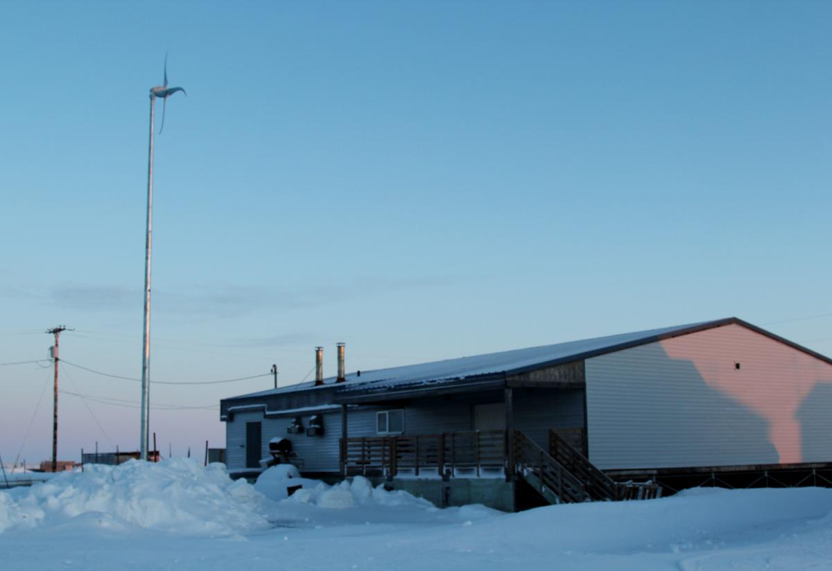 Shishmaref Tannery from the outside. A small wind turbine beside it adds supplemental power, which slightly lessens high fuel costs keeping the building warm during the short three-month seasons it is operating.