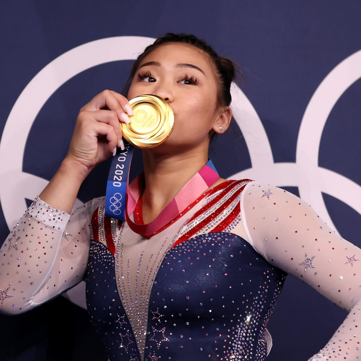 Sunisa Lee of Team United States poses with her gold medal after winning the Women's All-Around Final on day six of the Tokyo 2020 Olympic Games on July 29, 2021.