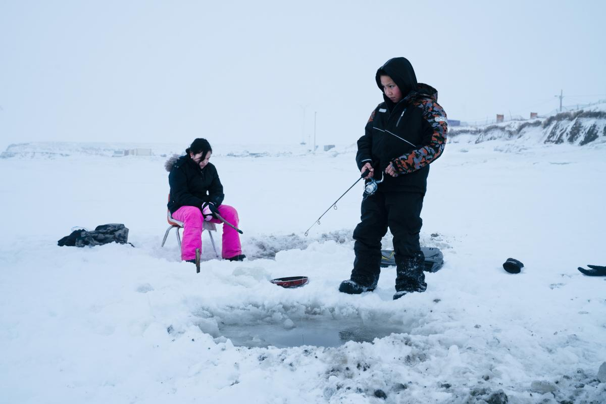 Joanna Woods, 12, (left) and her cousin Mick Chakuchin, 10, go ice fishing in Toksook Bay.