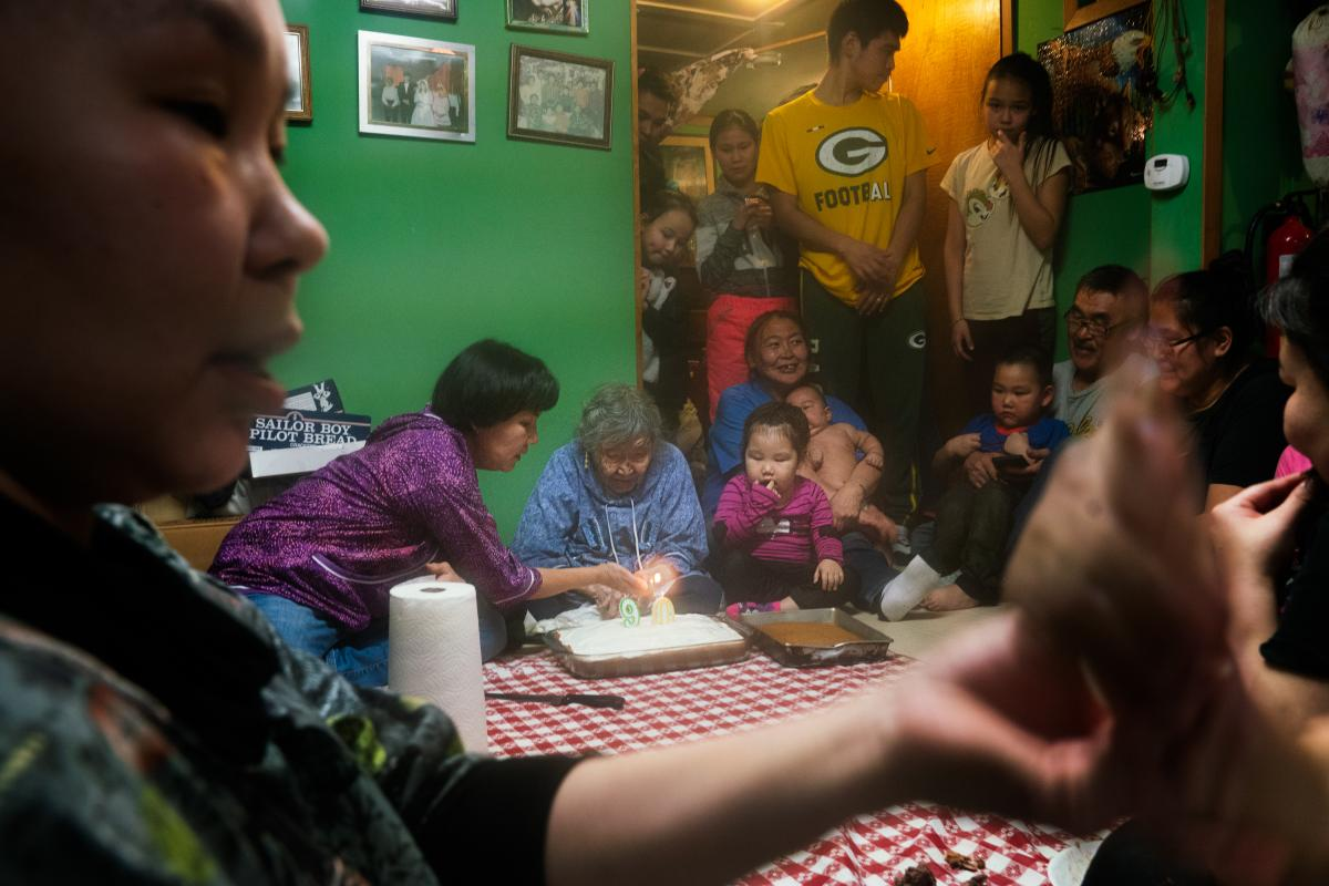 Lizzie Chimiugak Nenguryarr's family gathers to celebrate her 90th birthday at her home in Toksook Bay. She is expected to be the first person counted for the 2020 census.