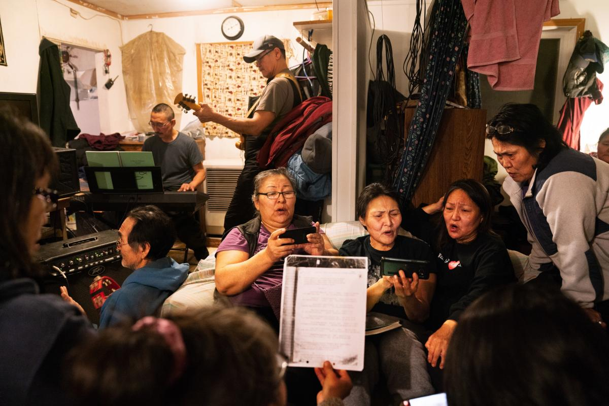 On Sunday night, people gather and practice singing hymns for George Paul Miisaq's funeral. Miisaq was living in Anchorage and his body was flown back to Toksook Bay to be buried.