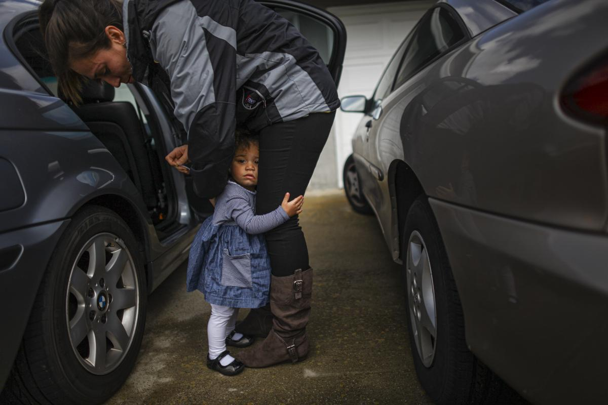Crystal Turner, a Marine veteran attending classes at Sierra College in Rocklin, Calif., helps her 1 1/2-year-old daughter, Marley Rose, out of a car.